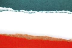 Rivit sönder paper på vit bakgrund Royaltyfri Fotografi