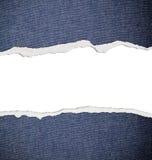 Rivit sönder papper, jeanstextur Fotografering för Bildbyråer