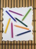 Rivit sönder papper med blyertspennor Royaltyfri Bild