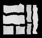 Rivit sönder papper och sönderrivet papper Arkivbilder