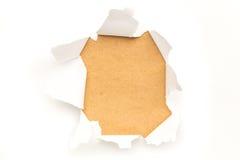 Rivit sönder pappers- hål arkivfoto