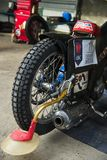 Rear wheel motorcycle in preparation for the race. Rivne, Ukraine - 11 October 2015: Rear wheel motorcycle in preparation for the race to the park service at the stock photos