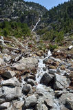 Rivulet in the mountain slope Stock Photography
