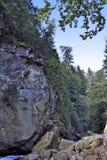 Riwer flows between rocks Royalty Free Stock Images