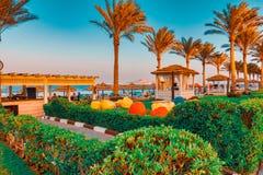 RIXxOS SHARM EL SHEIK, EGYPT - AUGUST 25, 2015: Hotel seaside area with beach bar in the afternoon sun.  stock photos