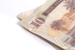 Riyal - arabiska pengar på vit Arkivfoto