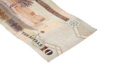 Riyal - arabiska pengar på vit Arkivbild