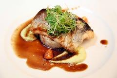 Riz avec des poissons et des aubergines Photo stock