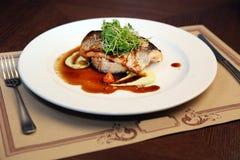 Riz avec des poissons et des aubergines Photographie stock