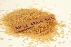 Riz entier de grain avec le label Photos stock