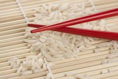 Riz et baguettes Photo stock