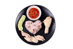 Riz huileux rouge-brun coulé et poulet coulé Image stock