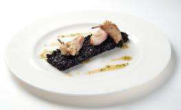 Riz noir avec les cailles rôties photo stock