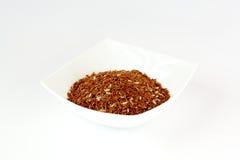Riz rouge dans un plat Image stock