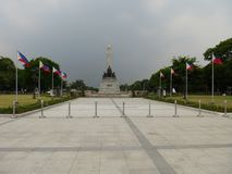 Rizal monument. At Luneta with Philippine flags Royalty Free Stock Image