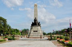 Rizal Park in downtown Manila on a beautiful day with blue sky and clouds looking towards the sculpture, park, and the Philippines royalty free stock photos