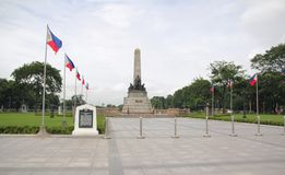 Rizal Park monument, Manila, Philippines. A monument of Philippine hero Dr Jose Rizal flanked by Philippine flags at the Rizal Park in Manila royalty free stock image
