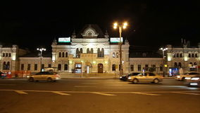 Rizhsky railway station (Rizhsky vokzal, Riga station) and night traffic in Moscow, Russia stock video footage