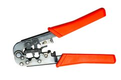 Modular crimping tool isolated on white background. RJ45 network crimper close up with red handles on white isolated background royalty free stock photos
