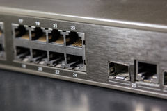 Rj45 ports and gbic port on front panel of a switch Royalty Free Stock Photography