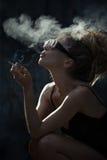 Röka för kvinna Arkivbilder