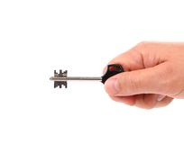 Ręka trzyma nowożytnego klingerytu klucz. Obrazy Royalty Free