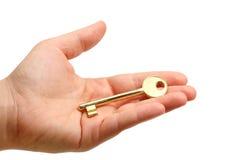 ręka złoty klucz Zdjęcia Stock