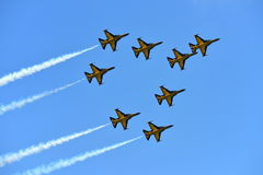 RKAF Black Eagles Aerobatic Team aerobatic performance at Singapore Airshow Royalty Free Stock Photography