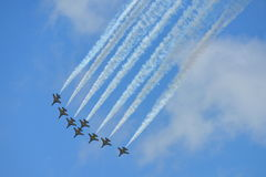 RKAF Black Eagles Aerobatic Team aerobatic performance at Singapore Airshow Royalty Free Stock Photo