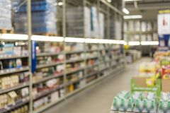 Rket in blurry for background. Abstract blur Background of Shelf of Snack and Candy in Grocery goods section in Supermarket or. Hypermarket Convenience Store as stock image