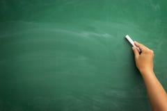 Ręki writing na blackboard Obrazy Royalty Free