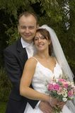Rld241. Portrait of bride and groom in embrace, UK, 2005 Stock Image