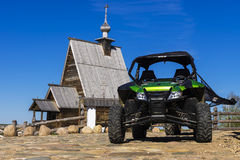 RLES, RUSSIA - MAY 9: the Arctic Cat Wildcat ATV - against old w Stock Images
