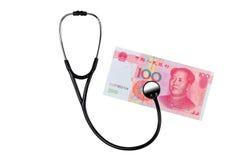 RMB和医疗听诊器 免版税库存图片