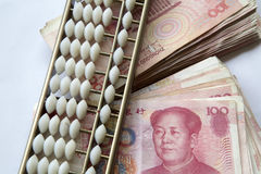 RMB and abacus. A stack of RMB and abacus background Royalty Free Stock Photography