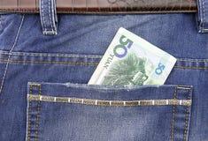 RMB dans la poche Images stock