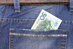 RMB in pocket. RMB banknote in pocket of jeans Stock Images