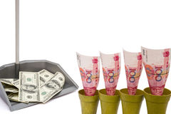 RMB rising and USD in rubbish bin. With clipping path Royalty Free Stock Photos