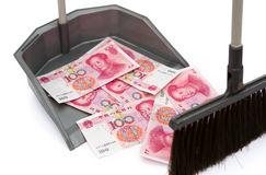 RMB in rubbish bin. And a  besom, monetary concept Royalty Free Stock Photo