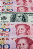 RMB and USD. USD in mid of RMB Royalty Free Stock Photo
