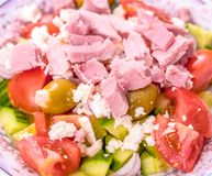 Diabetes healthy eating: large salad with proteins on top. Healthy diabetic eating: Simple Cuban salad made with cucumber, ham, tomatoes, garlic stuffed olives stock photo