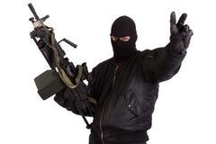 Rånare med maskingeväret Arkivfoto