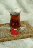Rning turkish tea in traditional glass with red paper heart, bre Stock Photo
