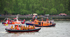 RNLI Boats Diamond Jubilee Pageant. RNLI Lifeboats on River Thames in London on June 3rd during the Royal Pageant, part of the Diamond Jubilee celebrations of Stock Photos