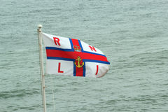 RNLI flag. Stock Images