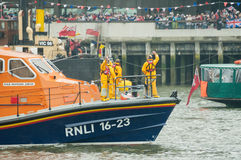 RNLI Lifeboat crew. Crew on-board the RNLB Diamond Jubilee maritime rescue boat, part of the one thousand vessel Queen Elizabeth II Diamond Jubilee Pageant on Royalty Free Stock Photos