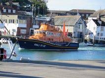 RNLI lifeboat entering Weymouth harbor in Dorset, UK Royalty Free Stock Photos