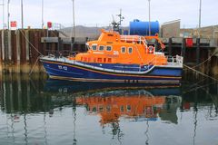 RNLI lifeboat moored to wharf Stock Photos