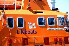 RNLI lifeboat, Weymouth. Orange RNLI lifeboat in the harbour, Weymouth, Dorset, England, UK, Western Europe stock photos