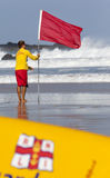 RNLI LIfeguard puts out Red Flag Royalty Free Stock Photos